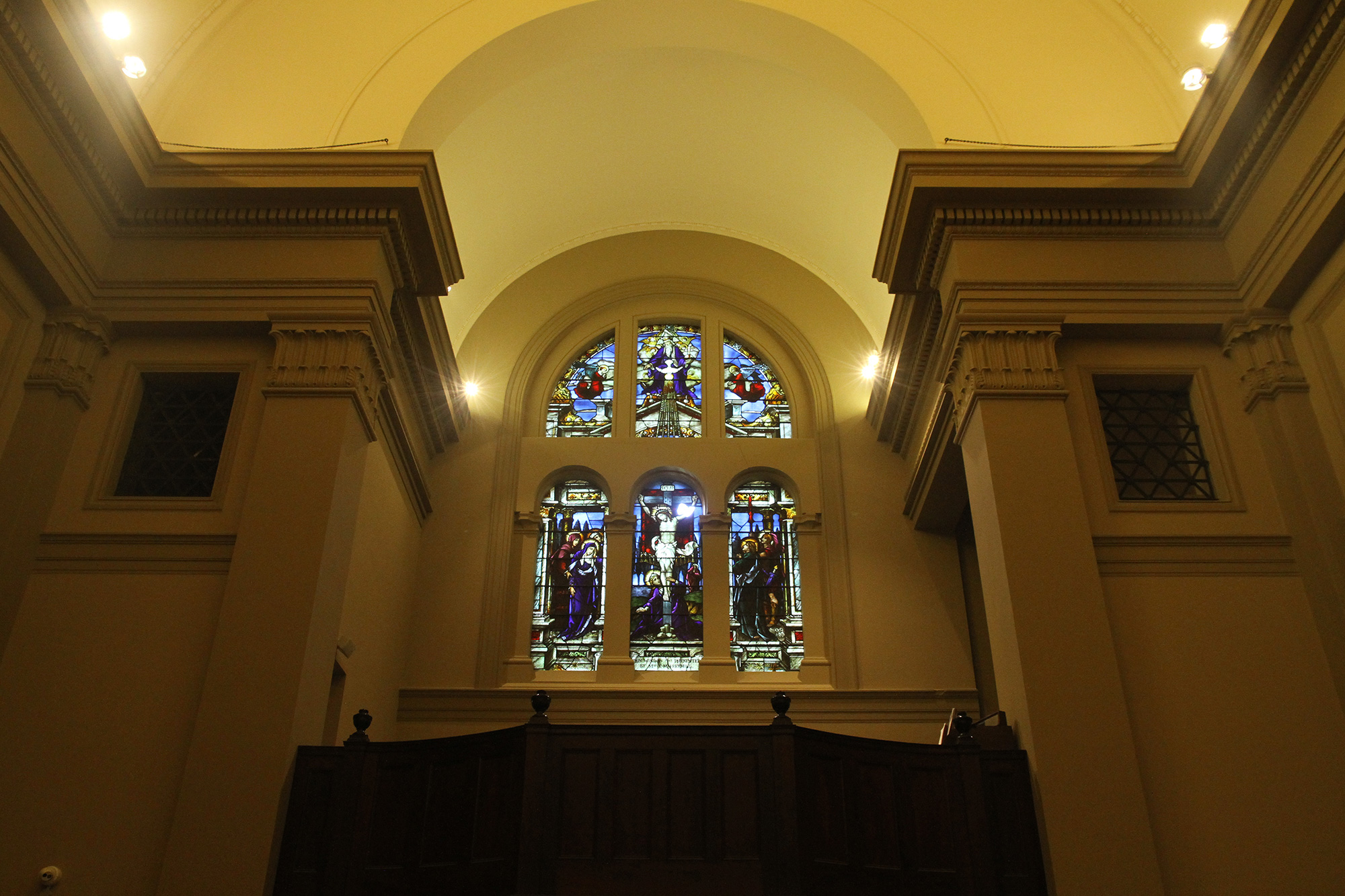 Rear stained glass window above the choir loft